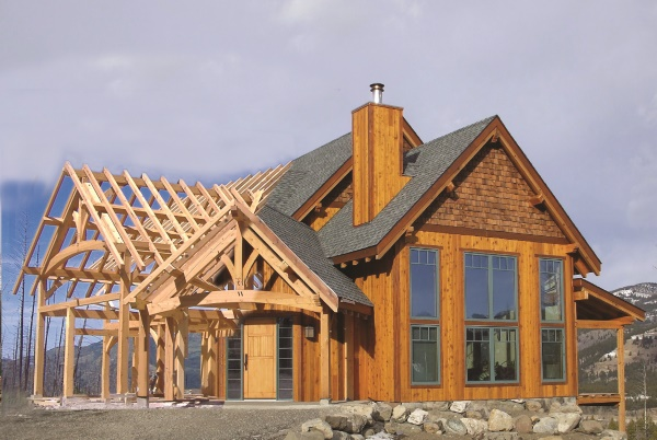 a timber frame becoming a hybrid timber frame house